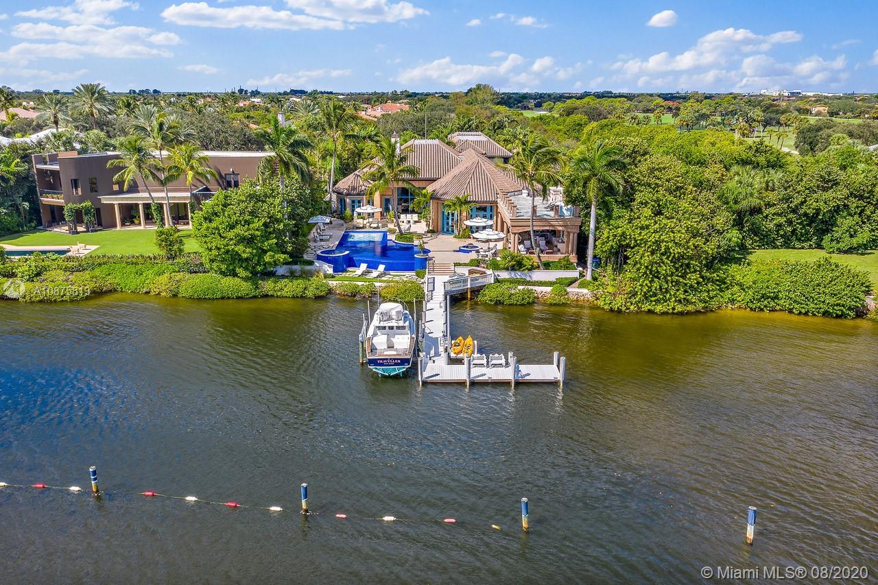 This magnificent estate home has an unobstructed view of the Intracoastal and Preserve. Grand foyer