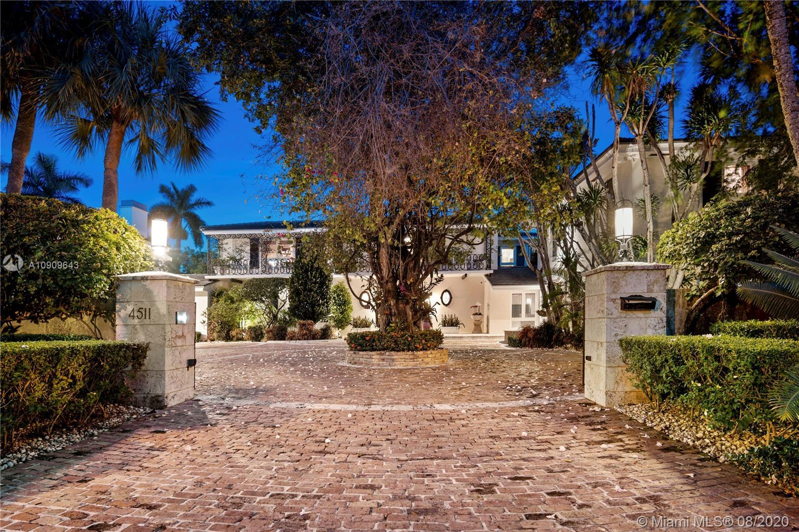 Nestled in the exclusive gated community of Bay Point, this stunning lakefront estate offers some of