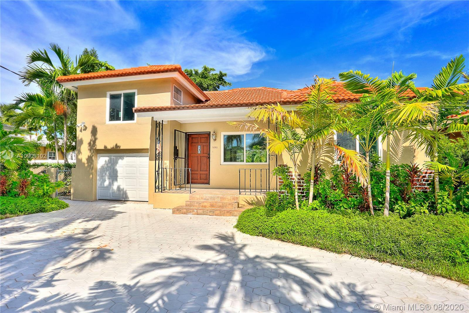 Beautifully remodeled beach home with Huge Backyard! This charming 3 BR and 2 BA plus a one car gara