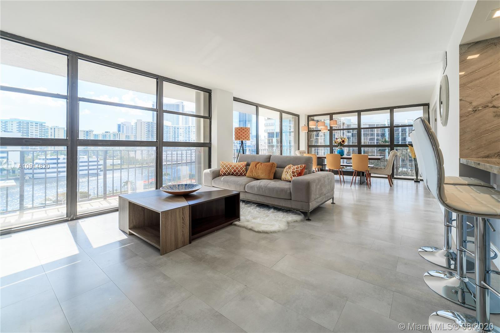 GORGEOUS 2 BDRS + A DEN (OFFICE SPACE) CORNER UNIT WITH WRAP AROUND BALCONY AND INTERCOASTAL VIEW. T