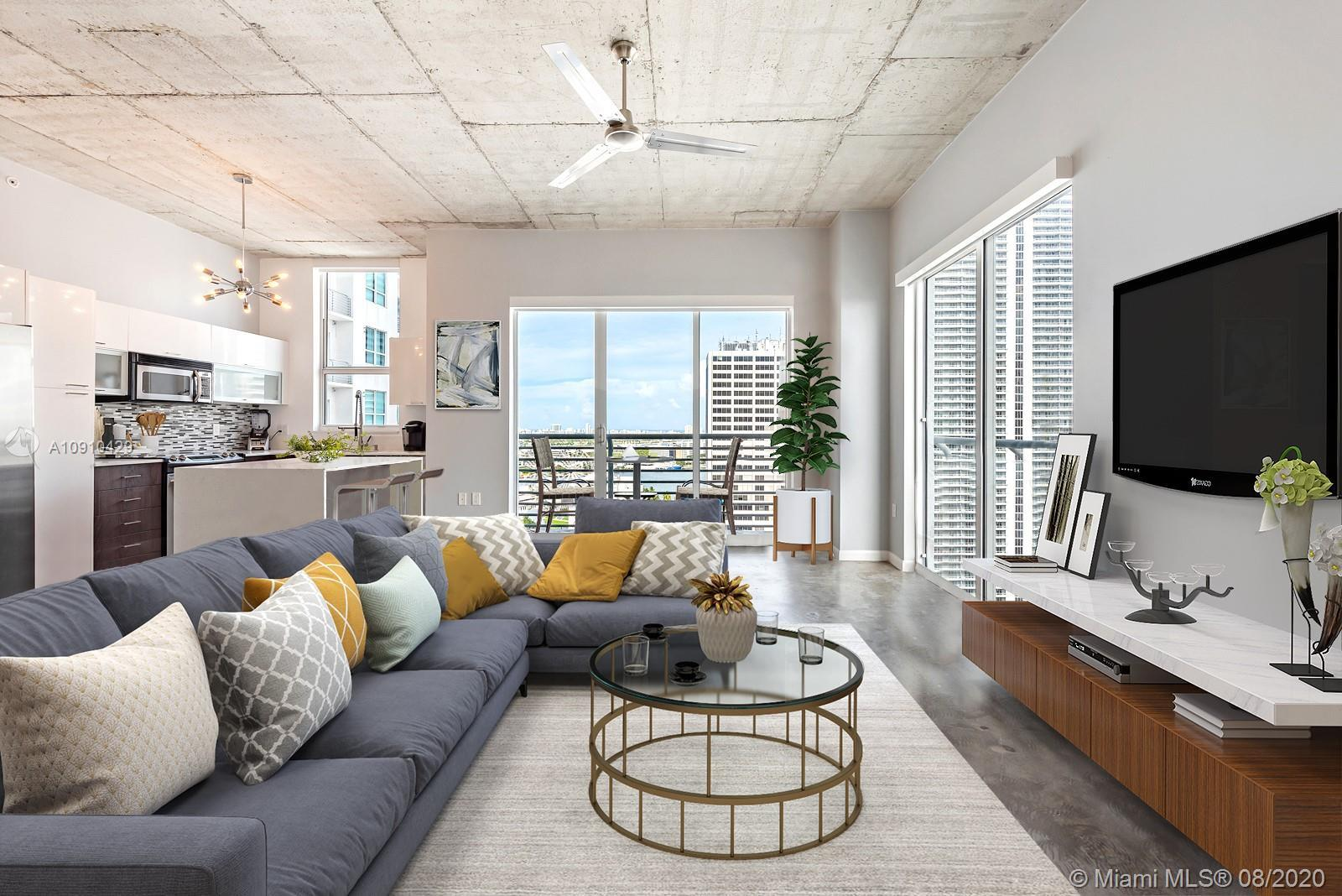 Downtown Miami meets Wynwood Glam! Gorgeously redone 2 bedroom 2 bath corner condo in this booming d