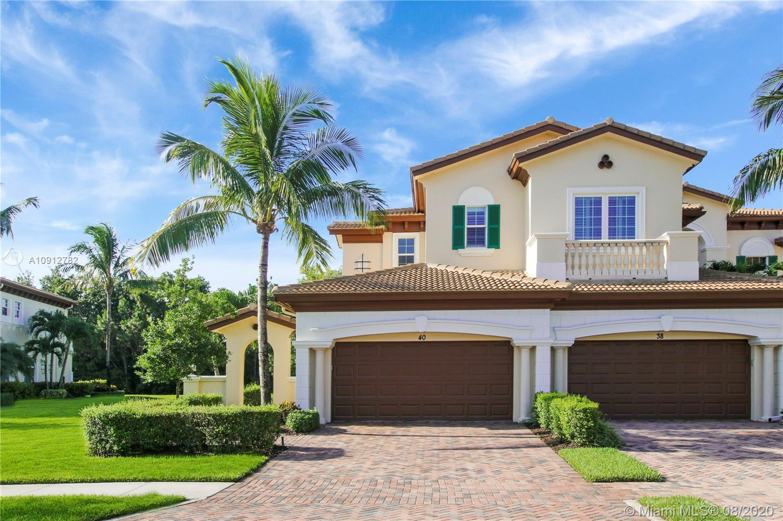 This newly offered carriage home in the exclusive gated community of Jupiter Country Club. This popu