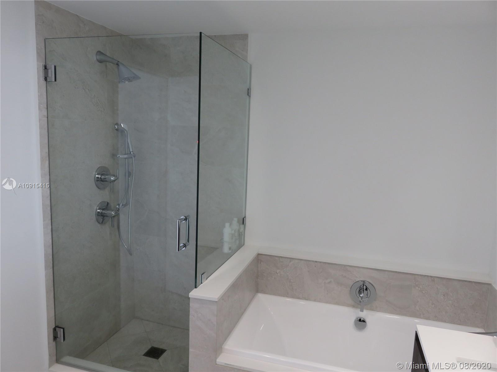 2 BEDS/2.5BATHS with direct views of Miami City skyline and partial bay! Unit has a large wrap aroun