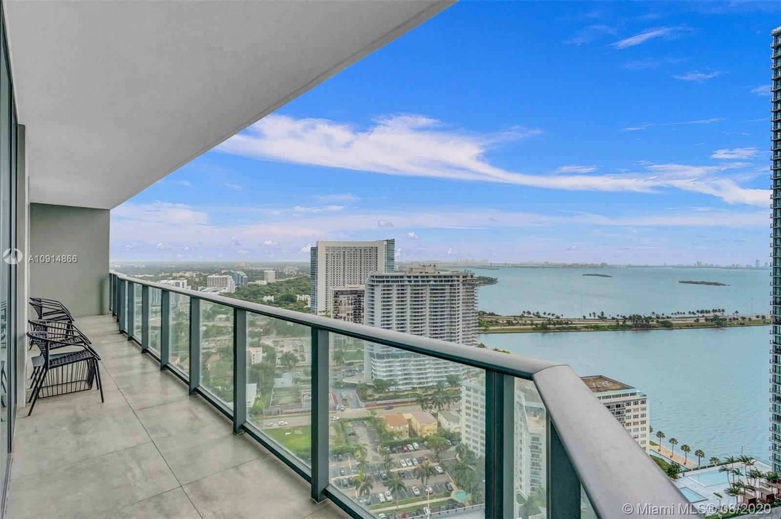 Beautiful designer decorated corner unit with stunning views of Biscayne Bay. Attention to detail in