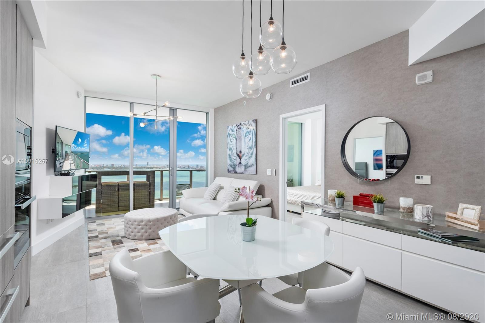 Stunning 3BR/ 3BA unit at the brand new Biscayne Beach Residences. Entertain in style across the 1,2