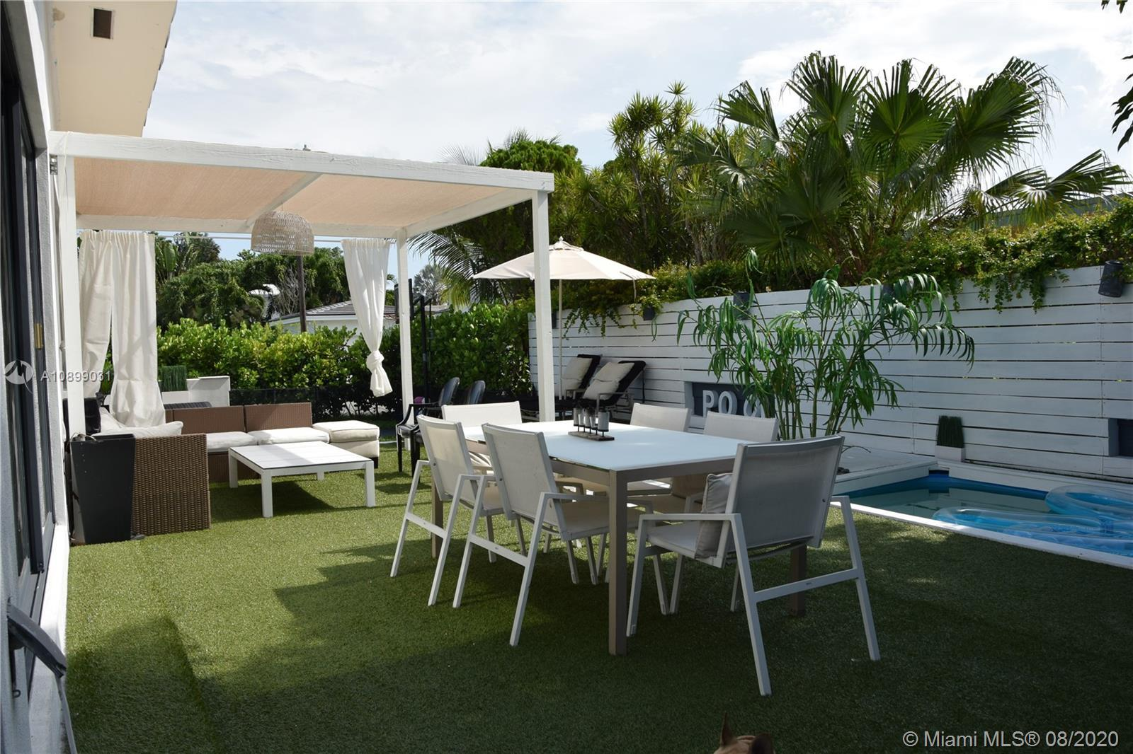 Steps to the pristine Beach in the Highly sought after ocean side Town of Surfside, Large corner hom