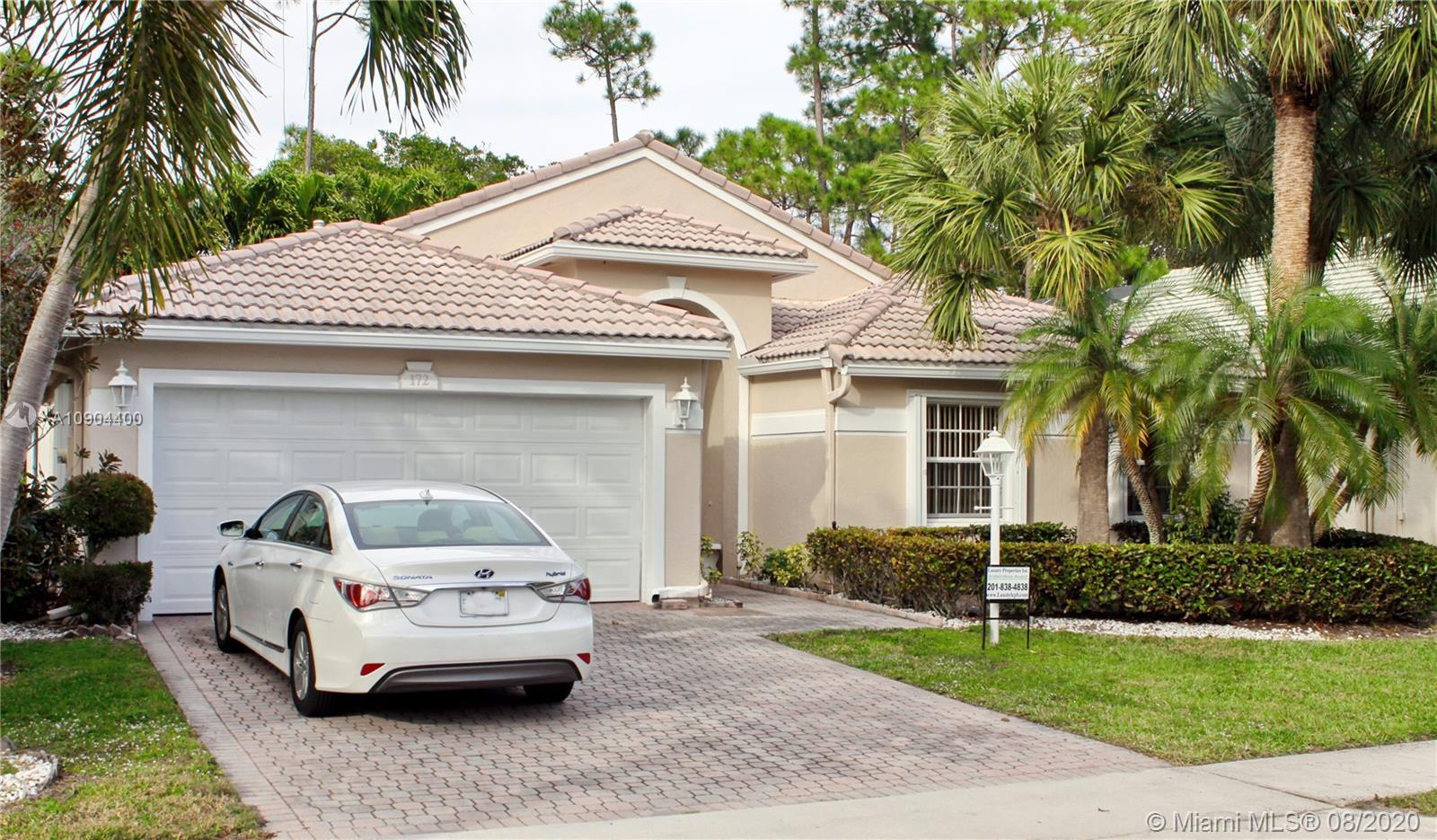 The home located in the heart of Jupiter. Waterfront with a canal for Ocean Access. Pride of ownersh