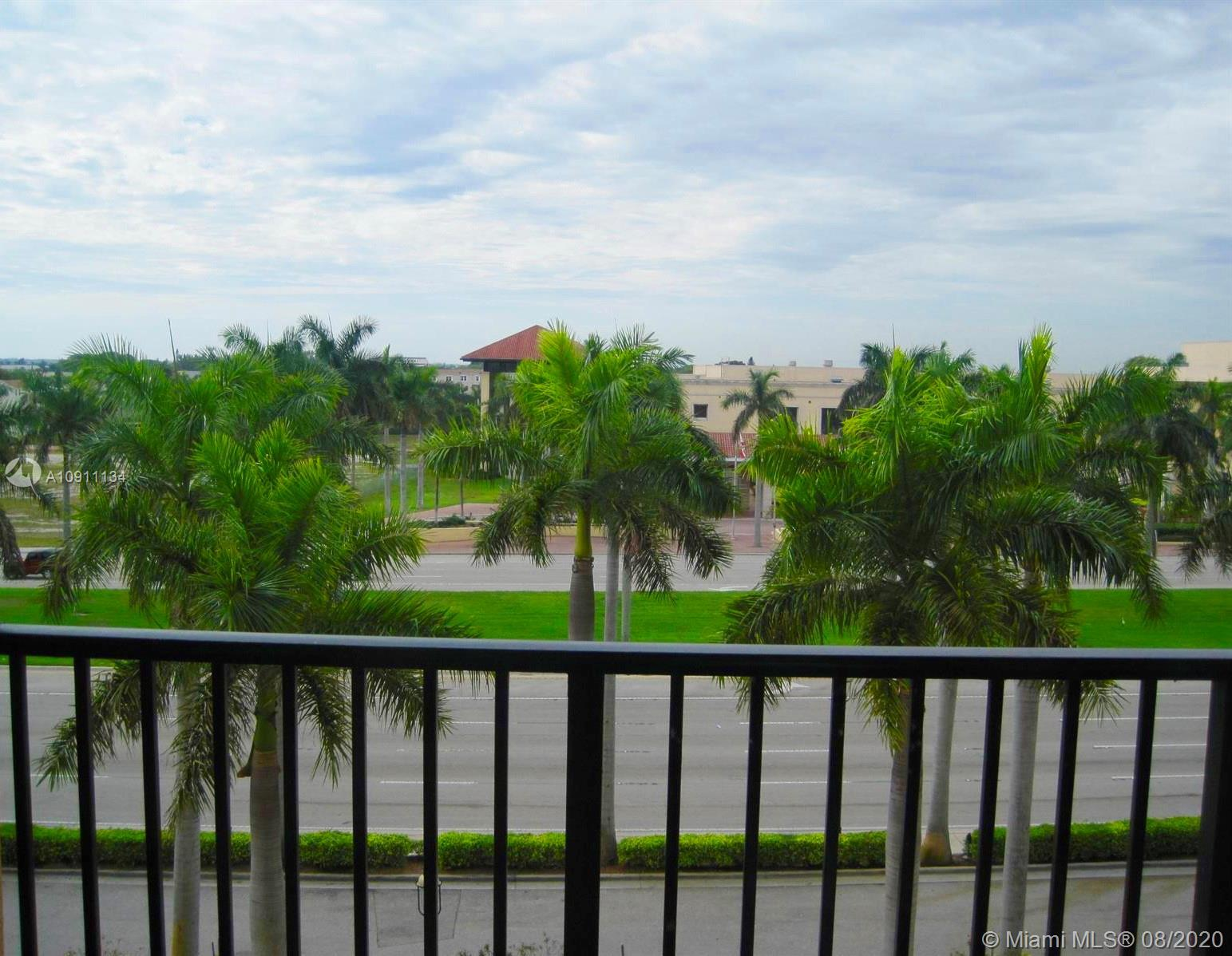 2 BR/2BA Downtown West Palm Beach Condo with Travertine Marble floors throughout.  Travertine marble