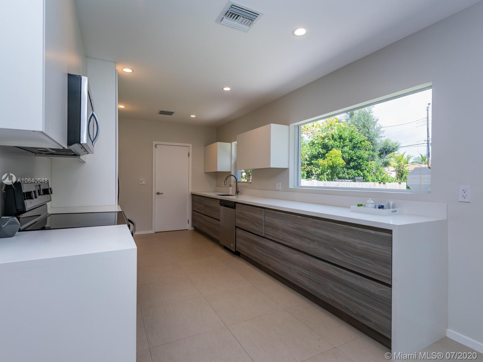 TOTALLY RENOVATED 3 bedroom home in prestigious Miami Shores Village. Brand new Impact Windows throu