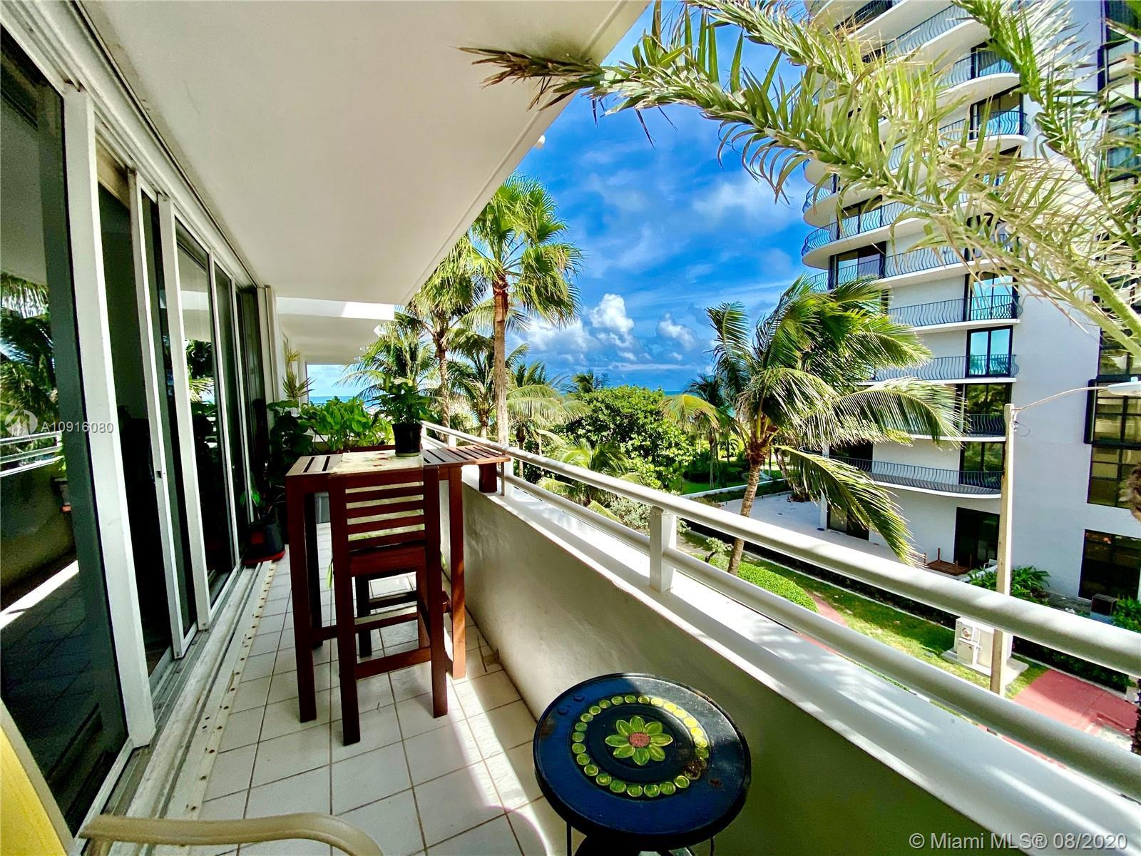 This Charming 2/2 Beach Condo features a side ocean view with large balcony, open kitchen, granite t