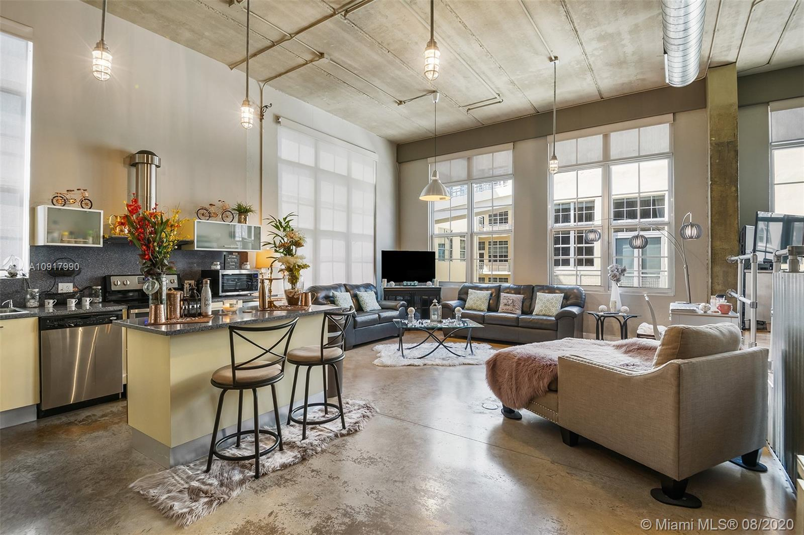 Dramatic NY style loft condo in the heart of Fort Lauderdale. This rarely available top floor corner