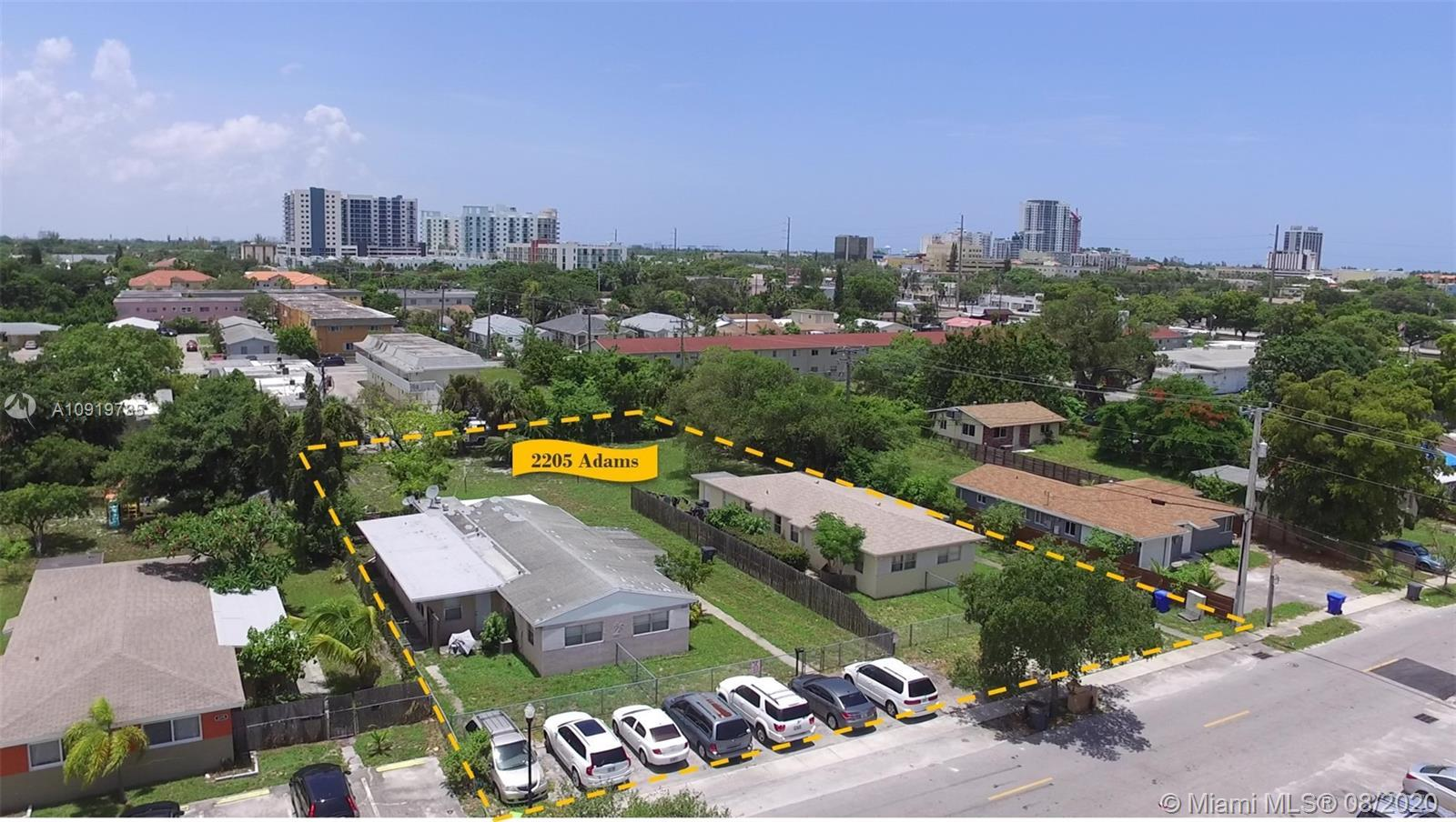 The rectangular lot measures +/- 26,650 and includes two duplexes generating excess income. The City