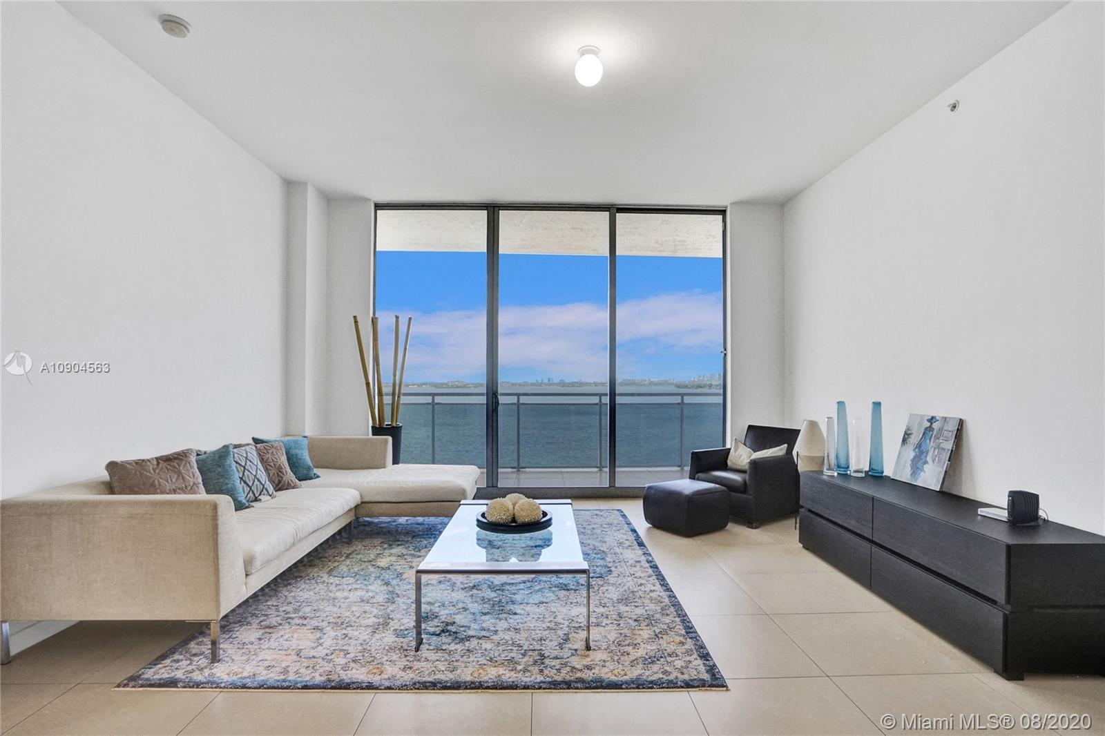 SPACIOUS AND BEAUTIFUL CONDO OFFERING ENDLESS unobstructed bay, OCEAN, city views FROM EVERY ROOM. b