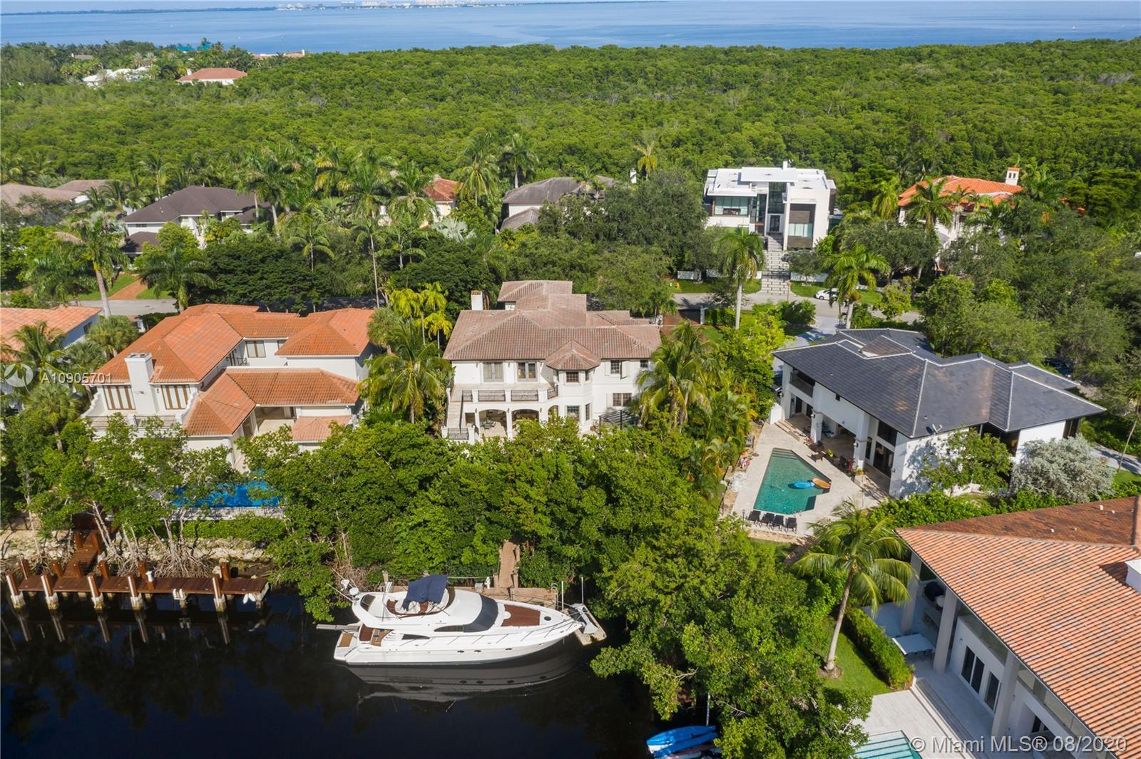 Mediterranean, timeless two-story waterfront in one of Miami's most prestigious neighborhoods. Fits