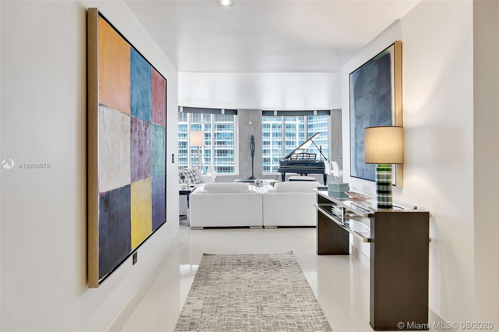 (optional) Fully furnished opportunity at exclusive Carbonell on Brickell Key! Designer's personal r