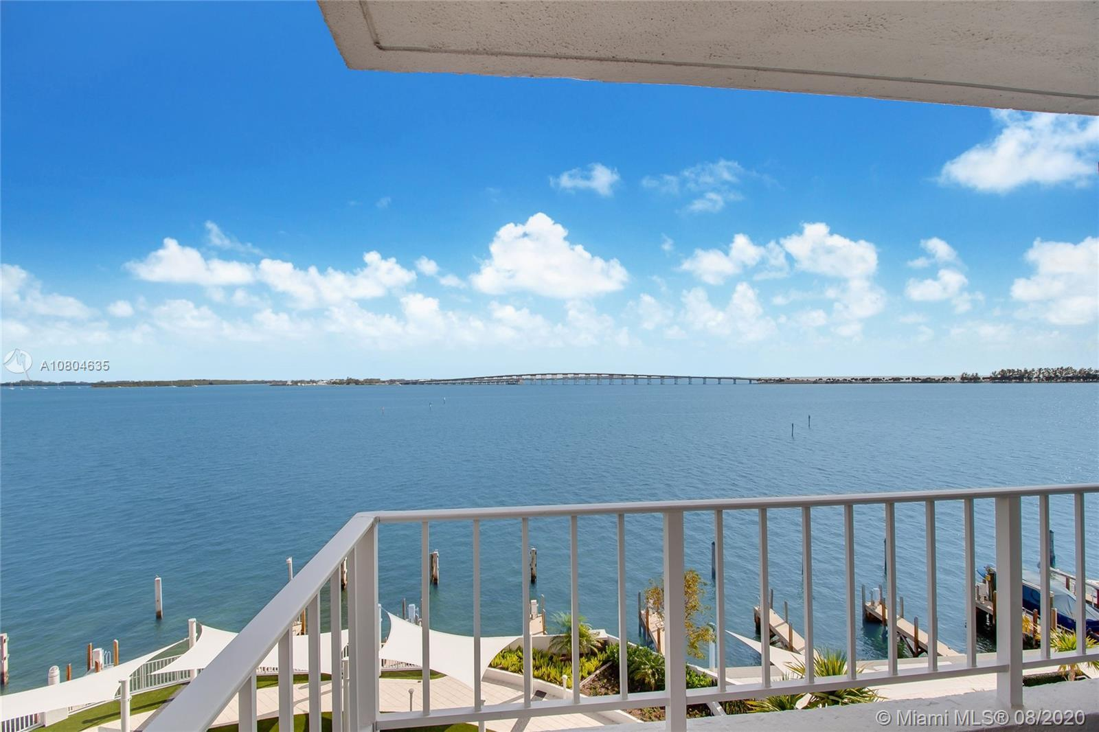 Smashing vistas of Biscayne Bay right from your pillow! This corner unit not only enjoys direct wate