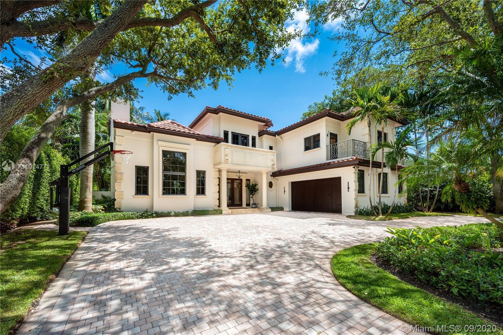 Exquisite home in private and guard-gated Bal Harbour Village, remodeled to perfection and available