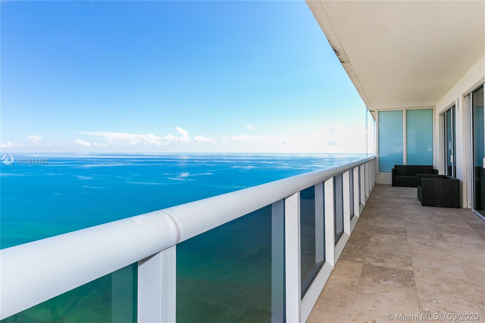 Immaculate Penthouse with wraparound balcony. Amazing ocean views together with the panorama of our