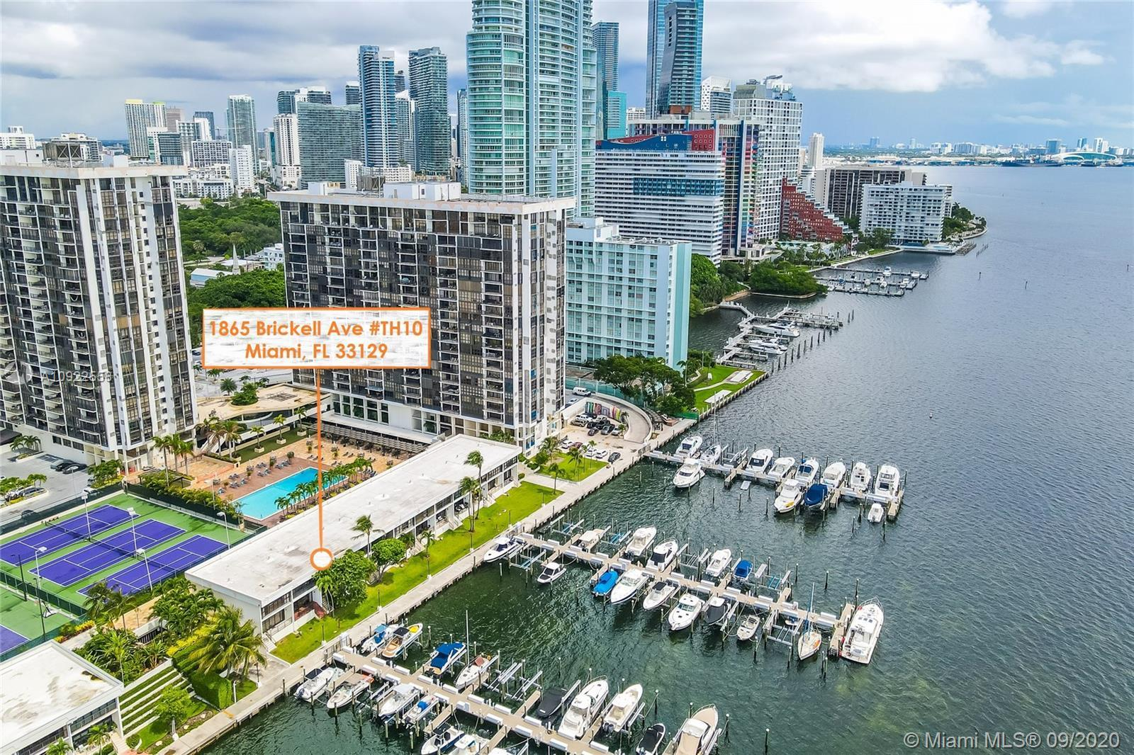 Fantastic townhouse right on Biscayne Bay facing Rickenbacker causeway. Partially remodeled. Two cov