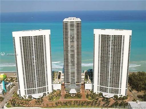 Huge corner unit full 2/2 right on the beach. Enjoy high floor ocean and city views. Building offers