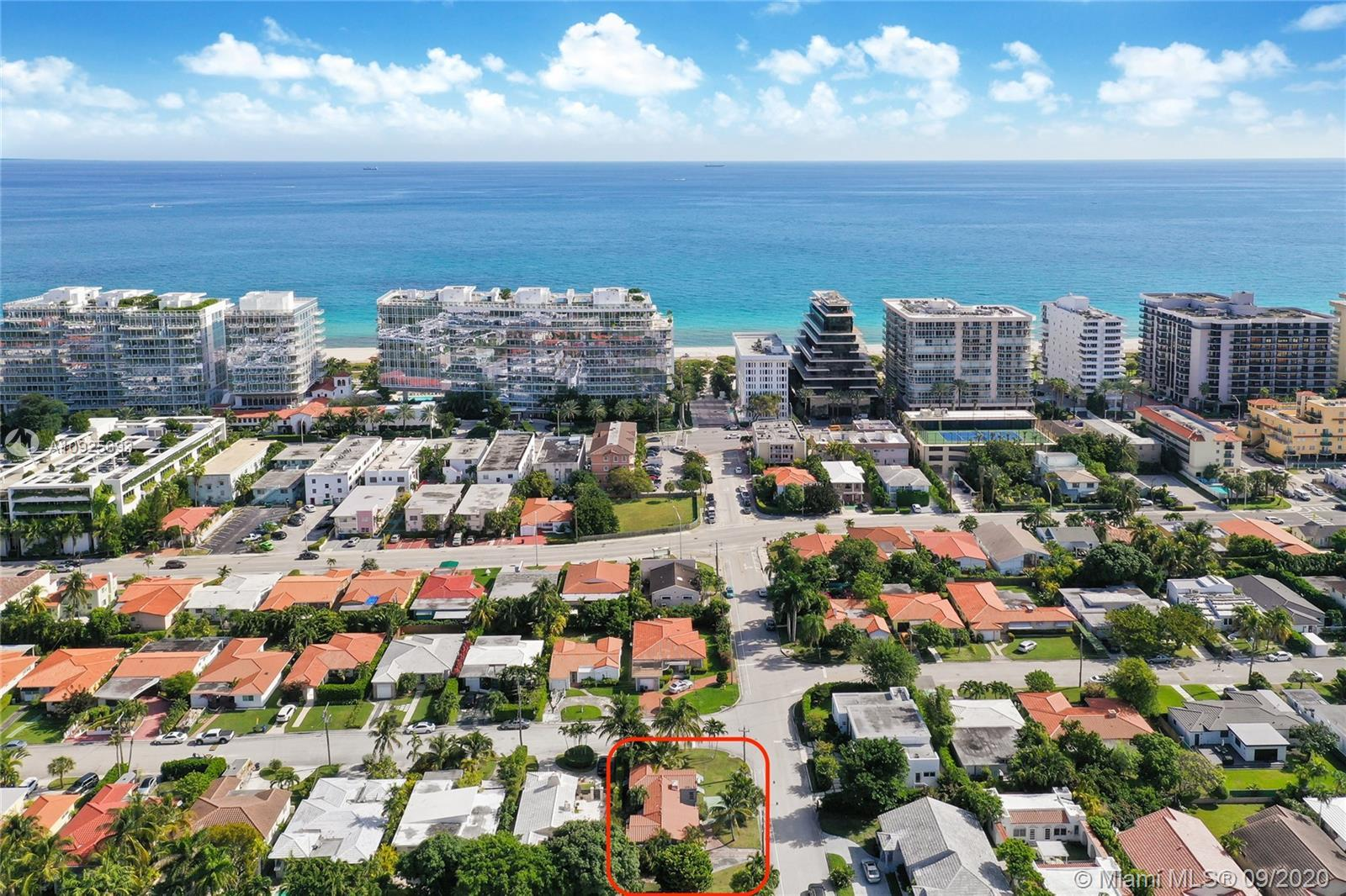 DEVELOPMENT OPPORTUNITY in sought-after SURFSIDE! This large corner lot with southern exposure is on