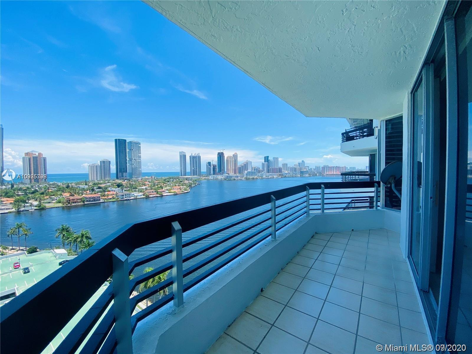 Breathtaking views of the Bay, Sunny Isles Beach and Ocean from this lower penthouse unit at exclusi