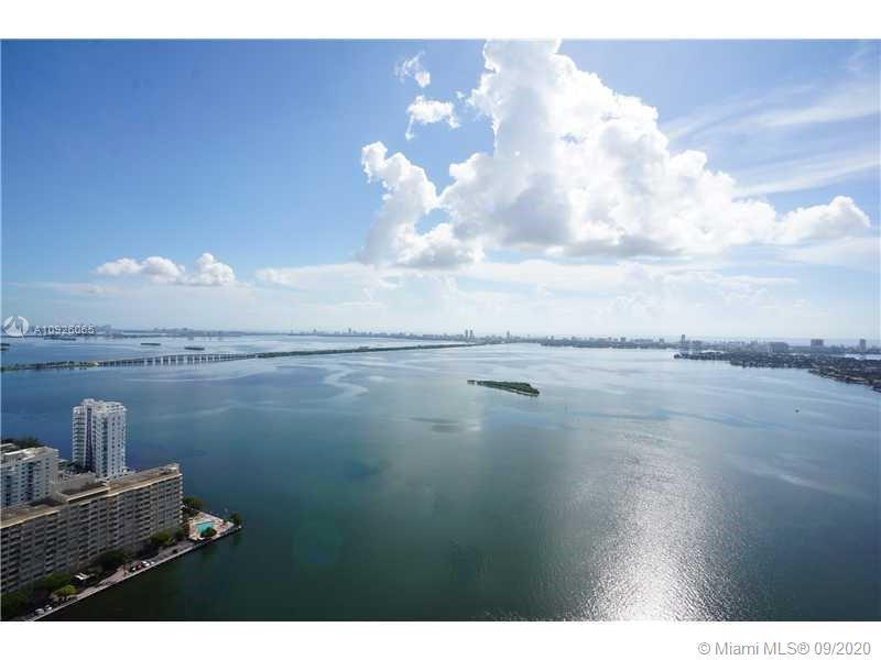 Beautiful & Well-Priced 3BR/3BA with Panoramic Bay View. Renovated Wood Flooring. Urban and Resort L