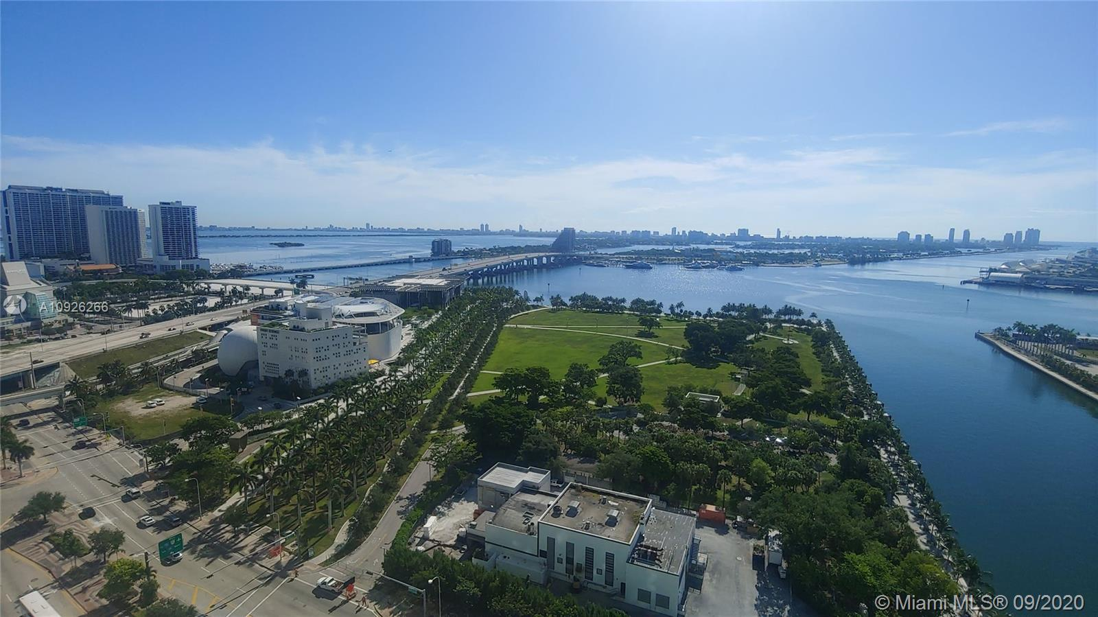 New listing, corner unit with amazing UNOBSTRUCTED water views!  2 Story Sky with 20 foot ceilings;