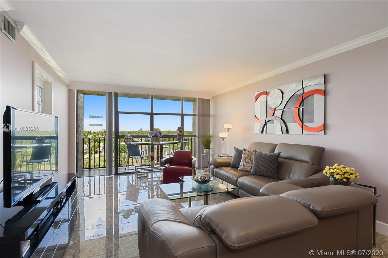This exquisite unit has been completely renovated from top to bottom! Ceiling to floor windows throu