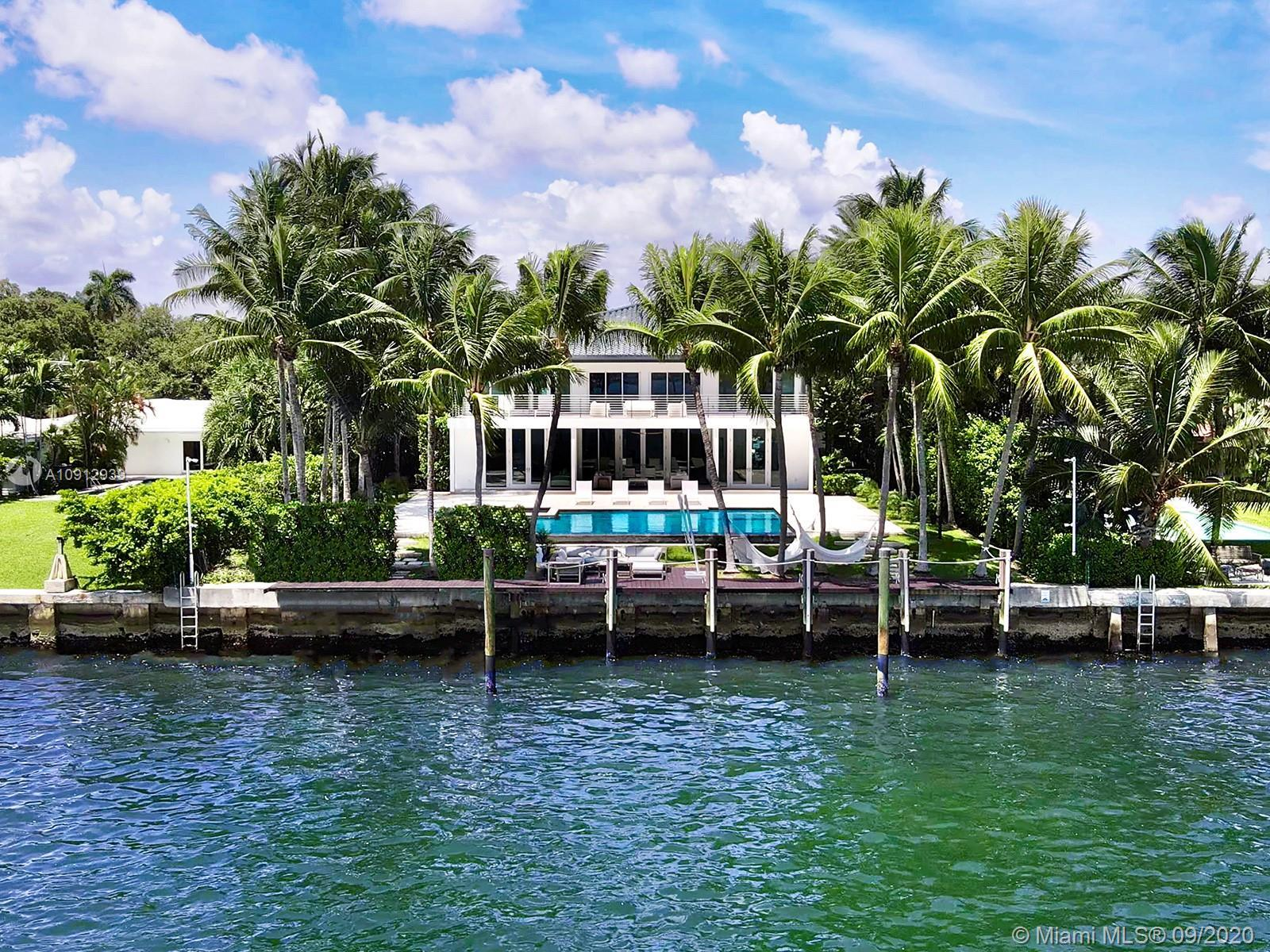 This stunning contemporary bayfront house in Miami's exclusive Bay Point neighborhood has been compl