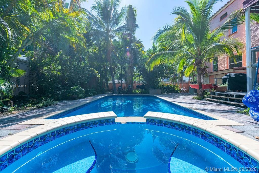 Charming Historic Spanish two story house with oversize pool and surrounded by tropical vegetation.