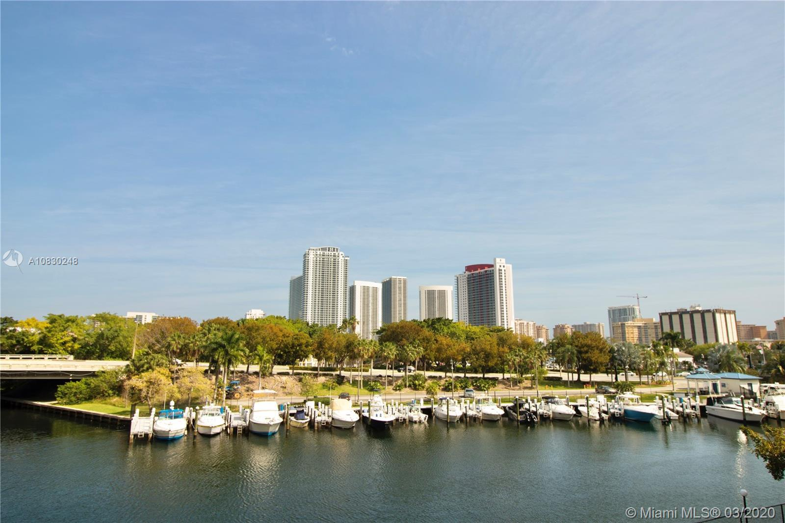 MAGNIFICENT LARGE & BRIGHT 2 BED/2 BATH OPEN CONCEPT SPLIT FLOOR PLAN OVERLOOKING CANAL & MARINA IN