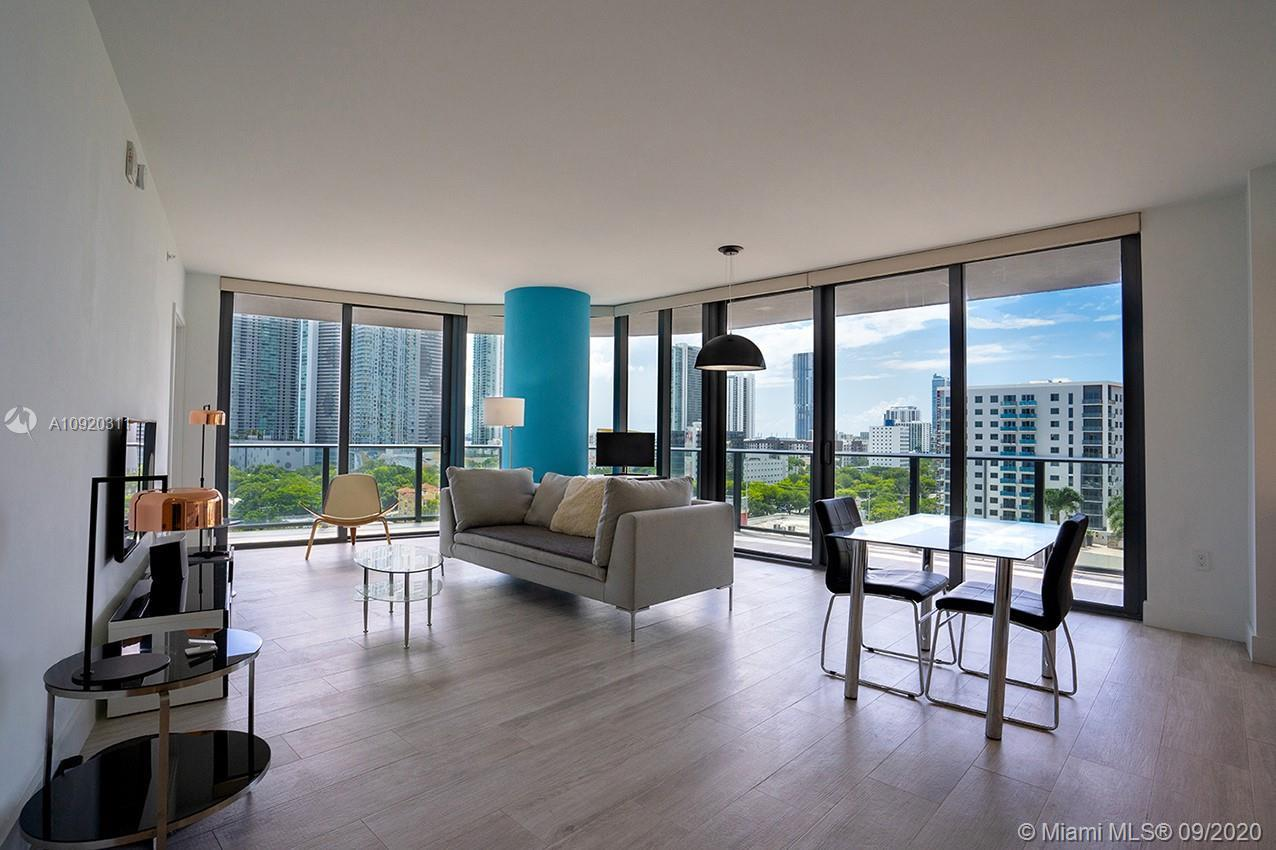 LOWEST PRICE IN THE BUILDING!!DESIRABLE LUXURIOUS CORNER UNIT WITH WRAP AROUND BALCONY ONE OF THE LA