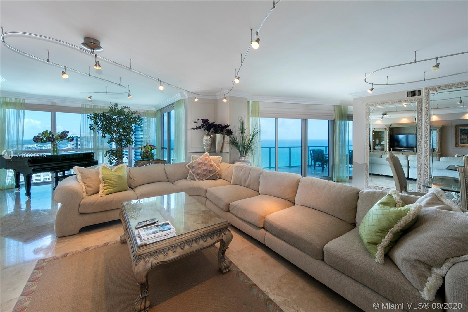 Spacious 3,466sf 4 bed/3.5 bath flow through condo with Ocean & Intracoastal views from every room.