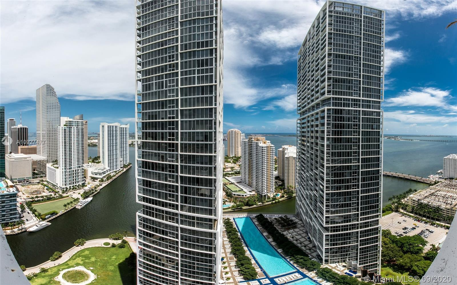 Luxury 1-bedroom with east exposure and 180 degrees views to Biscayne Bay and the Miami River. Turnk