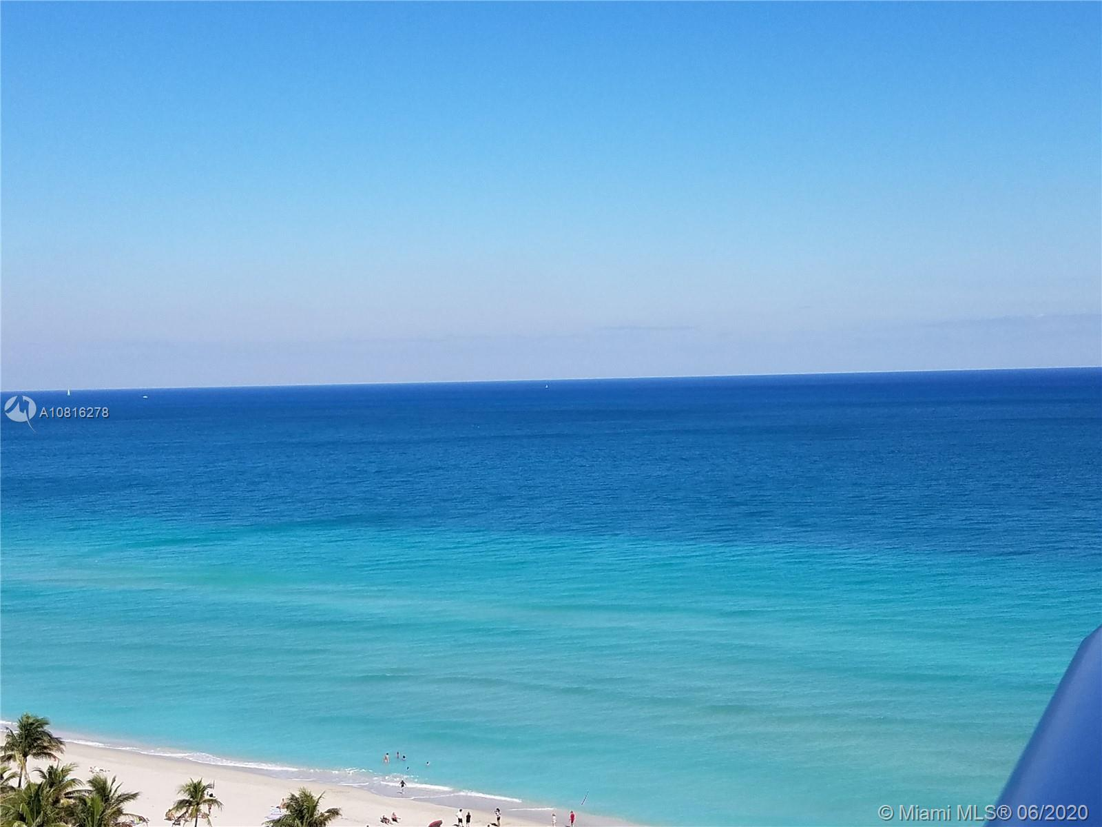 Oceanfront building. Direct view of the beach and the ocean from this penthouse; unit upgraded and c