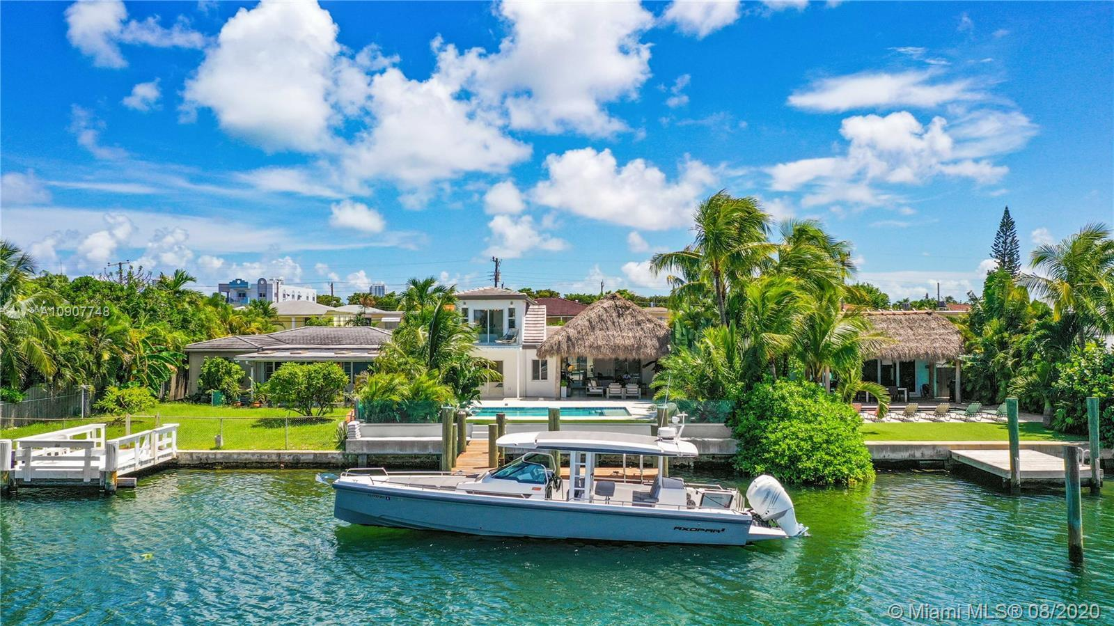 This is the one. This home epitomizes the reason to live in Miami. Located in deep water on a wide b