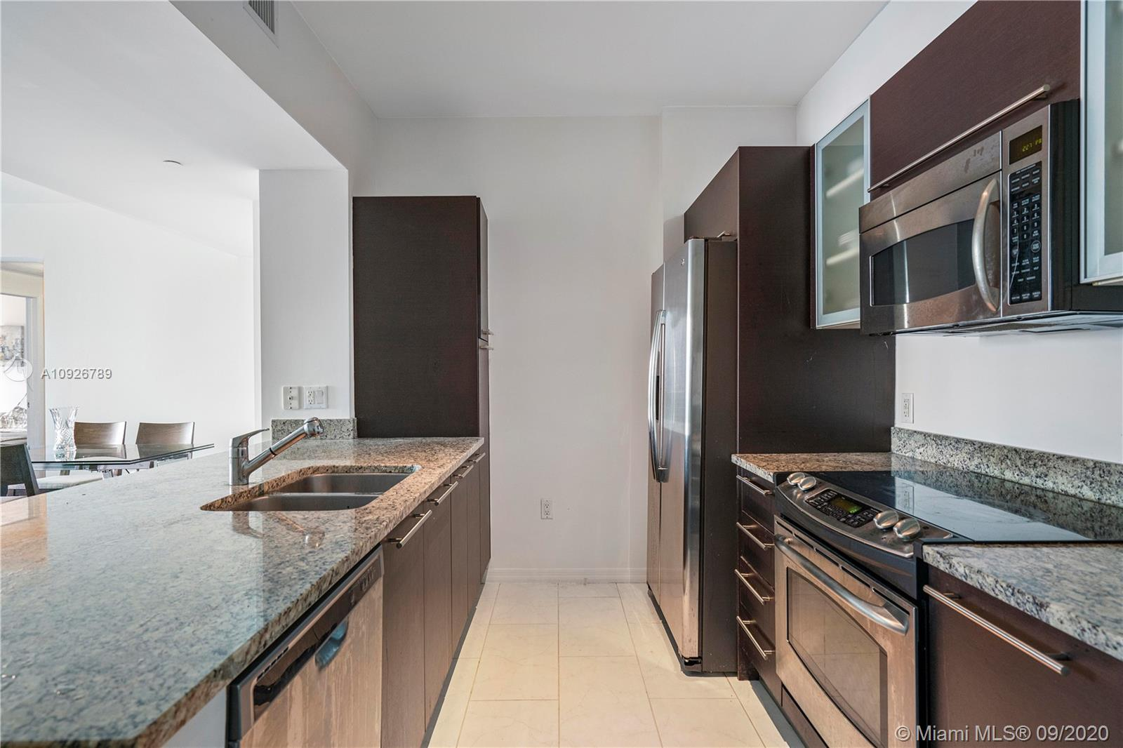 Bright 2 bedroom 2 Bath with open west skyline views with beautiful hardwood floors and bright white