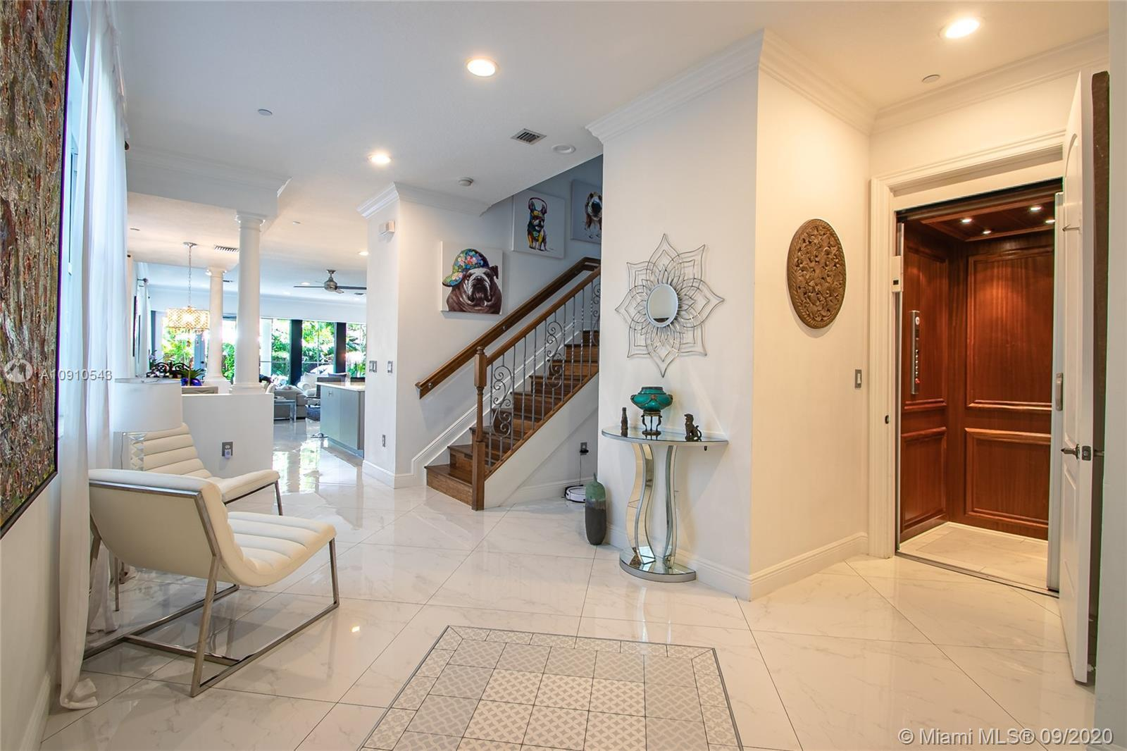 Stunning, totally renovated property with open floor plan , private elevator, hurricane windows and