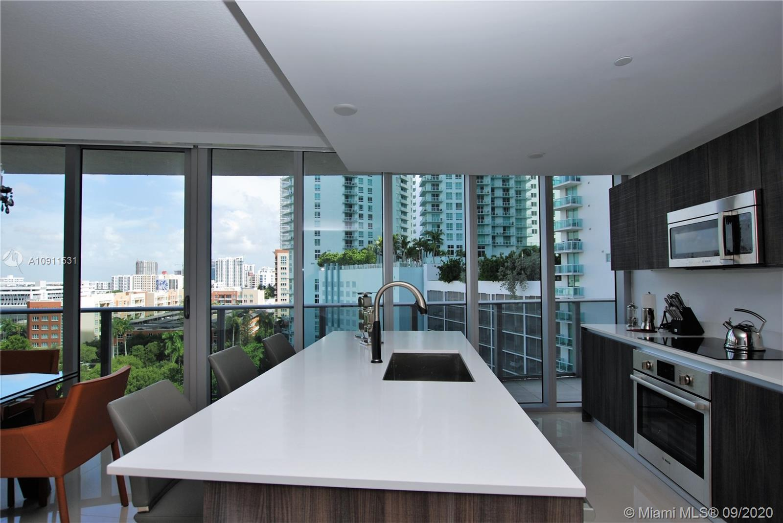 Turnkey unit! Amazing fully furnished 2 bedrooms and 2.5 half baths at Aria on the Bay in Miami. Gre