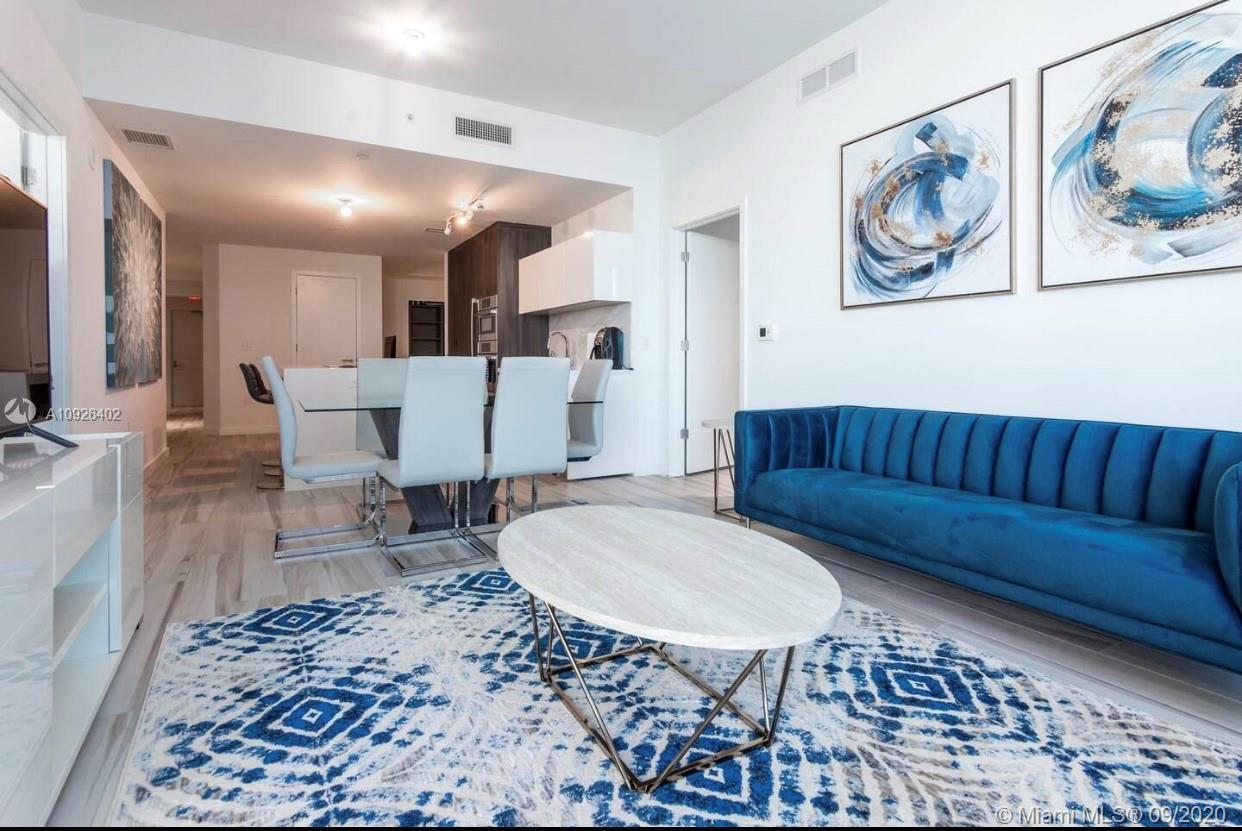 Fully FURNISHED 3 Beds / 3 Full Bathrooms with more than 150k in updates. Located in the Building no