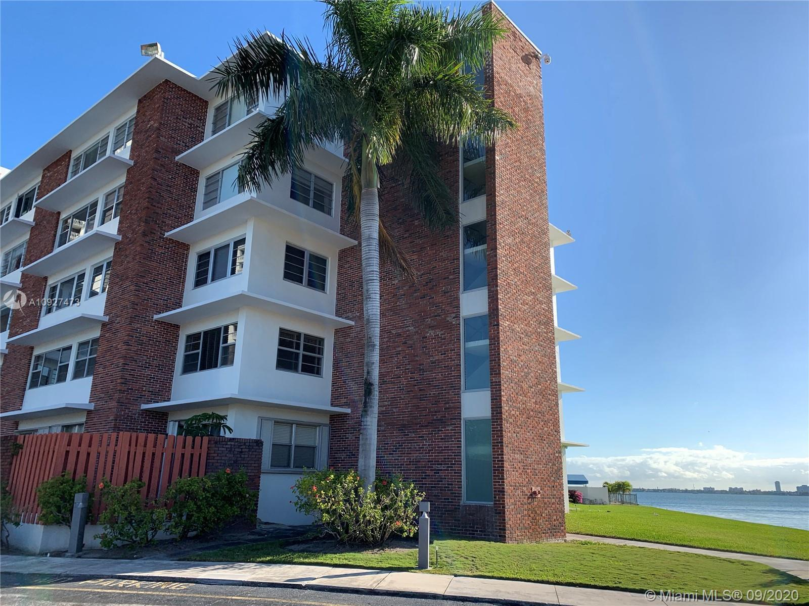 Bayfront building with community dock conveniently located in Miami Shores. Large Bedroom with two c
