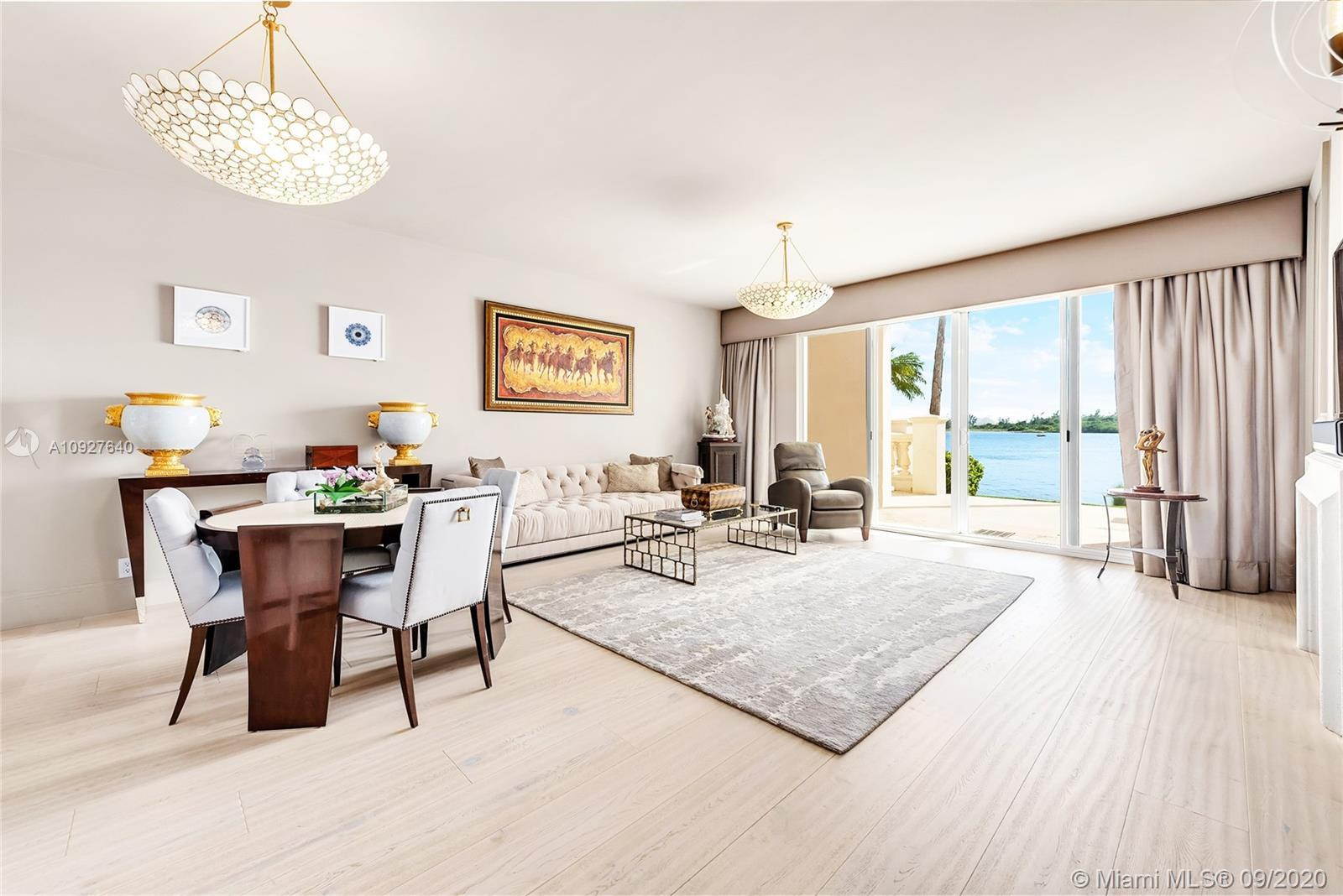 This contemporary, 1st floor condo on exclusive Fisher Island is impeccably decorated and has underg