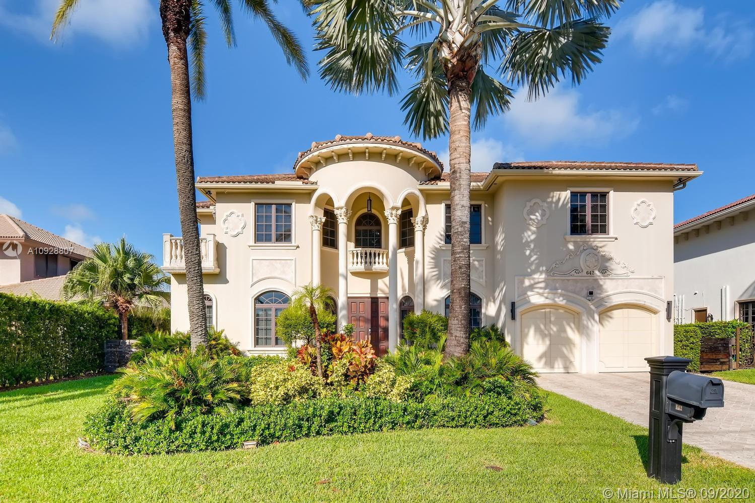 GORGEOUS MEDITERRANEAN STYLE MANSION IN GOLDEN ISLES. TWO STORIES WITH 6 BEDS, 7/1 BATHS + MAIDS ROO
