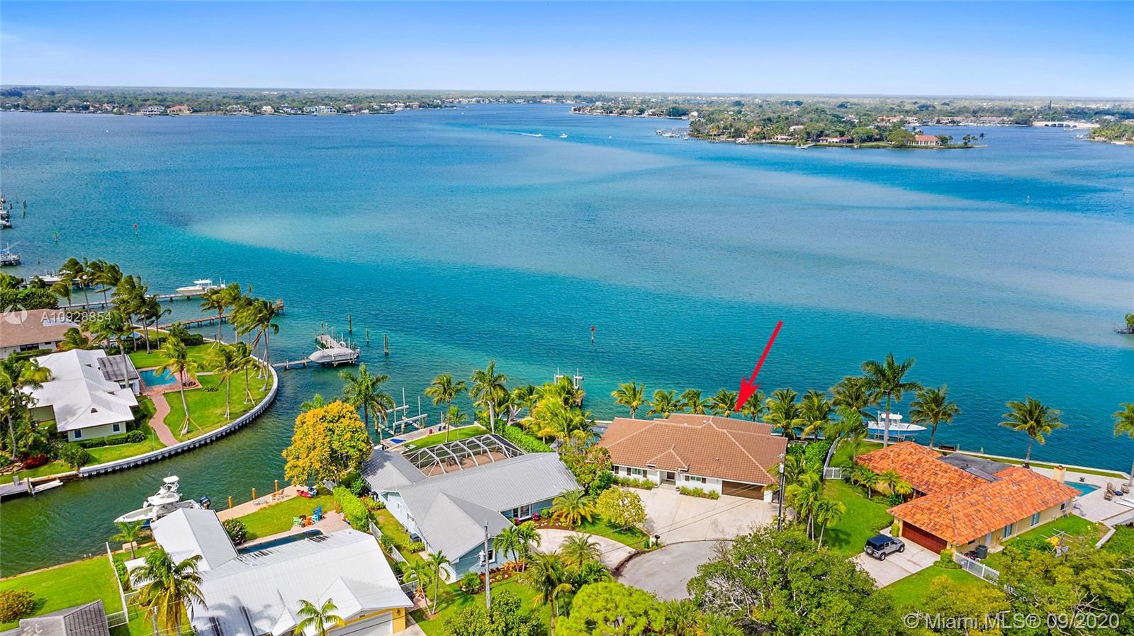 STUNNING - WATERFRONT POOL HOME Situated on a Premium Point Lot in the Heart of Jupiter. This Comple