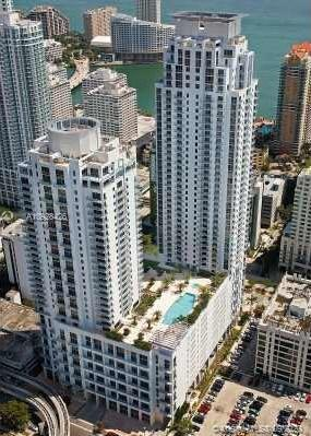 Penthouse, loft 13' ceilings, skyline + partial bay views, in the heart of Brickell, close to the re