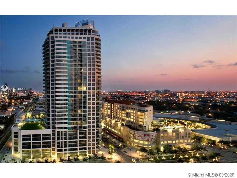 Exceptional and spacious 2 / 2.5 penthouse level condo in sought-after Midtown Miami. Floor to ceili