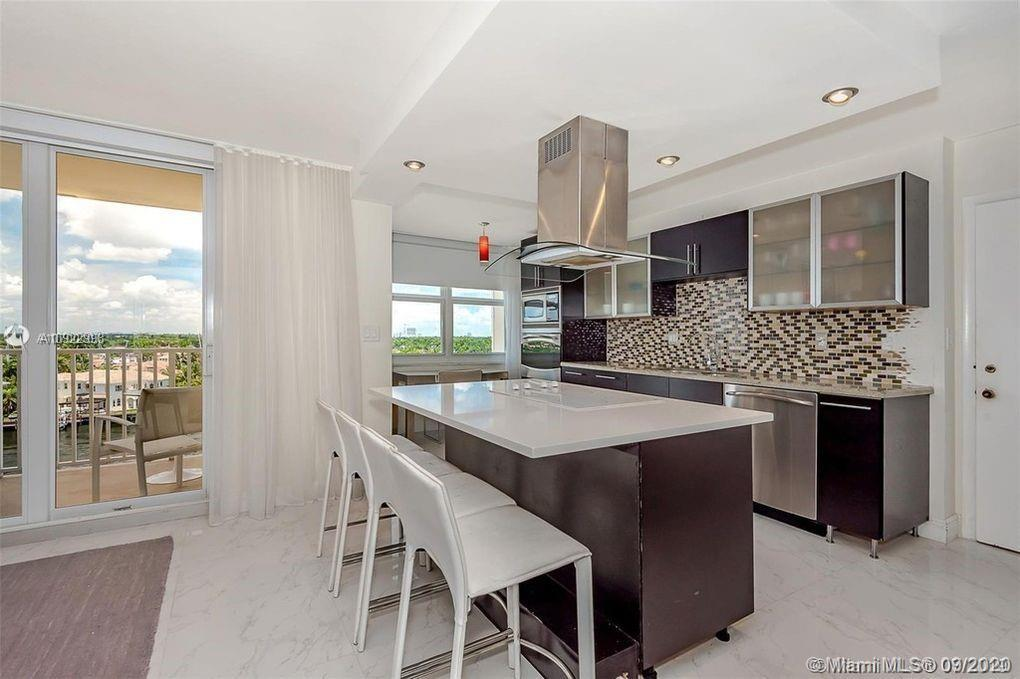 Beautifully remodeled corner unit features kitchen with center island w/white quartz, cook top, and