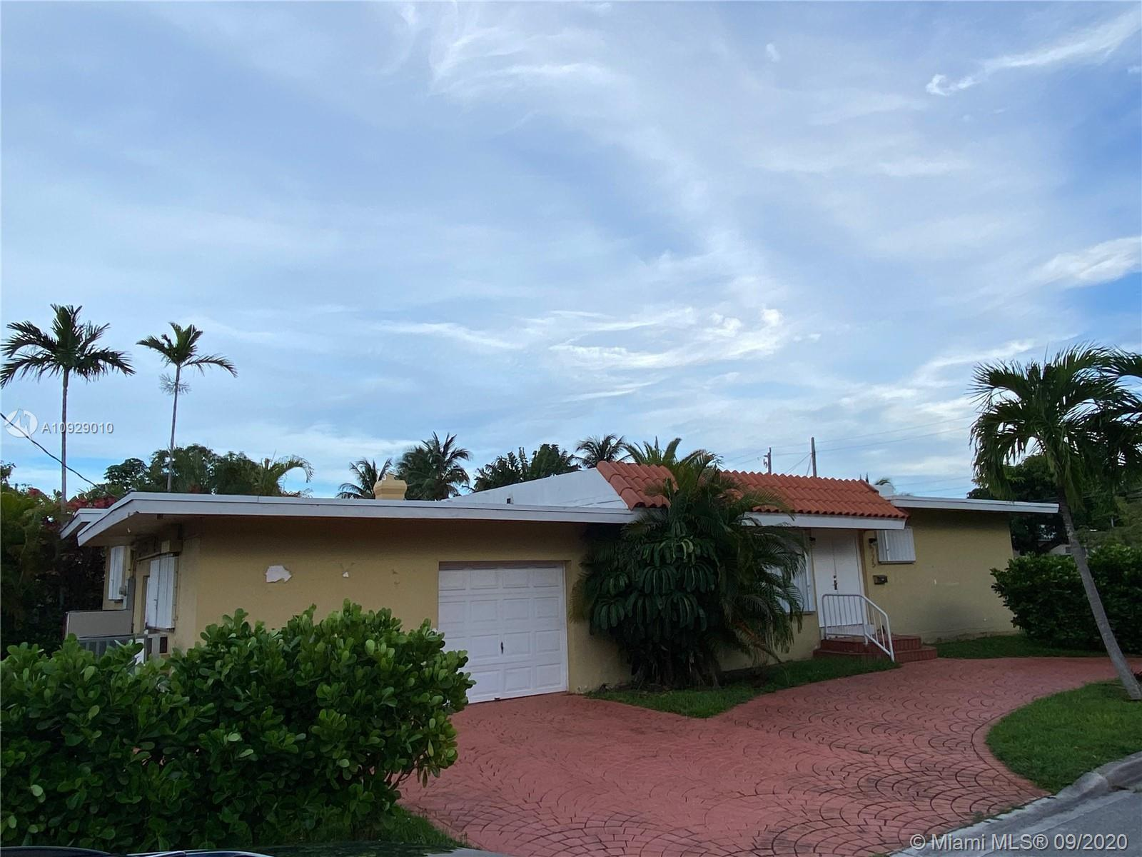 This is a wonderful opportunity to renovate this phenomenal corner-lot Surfside home and make it you