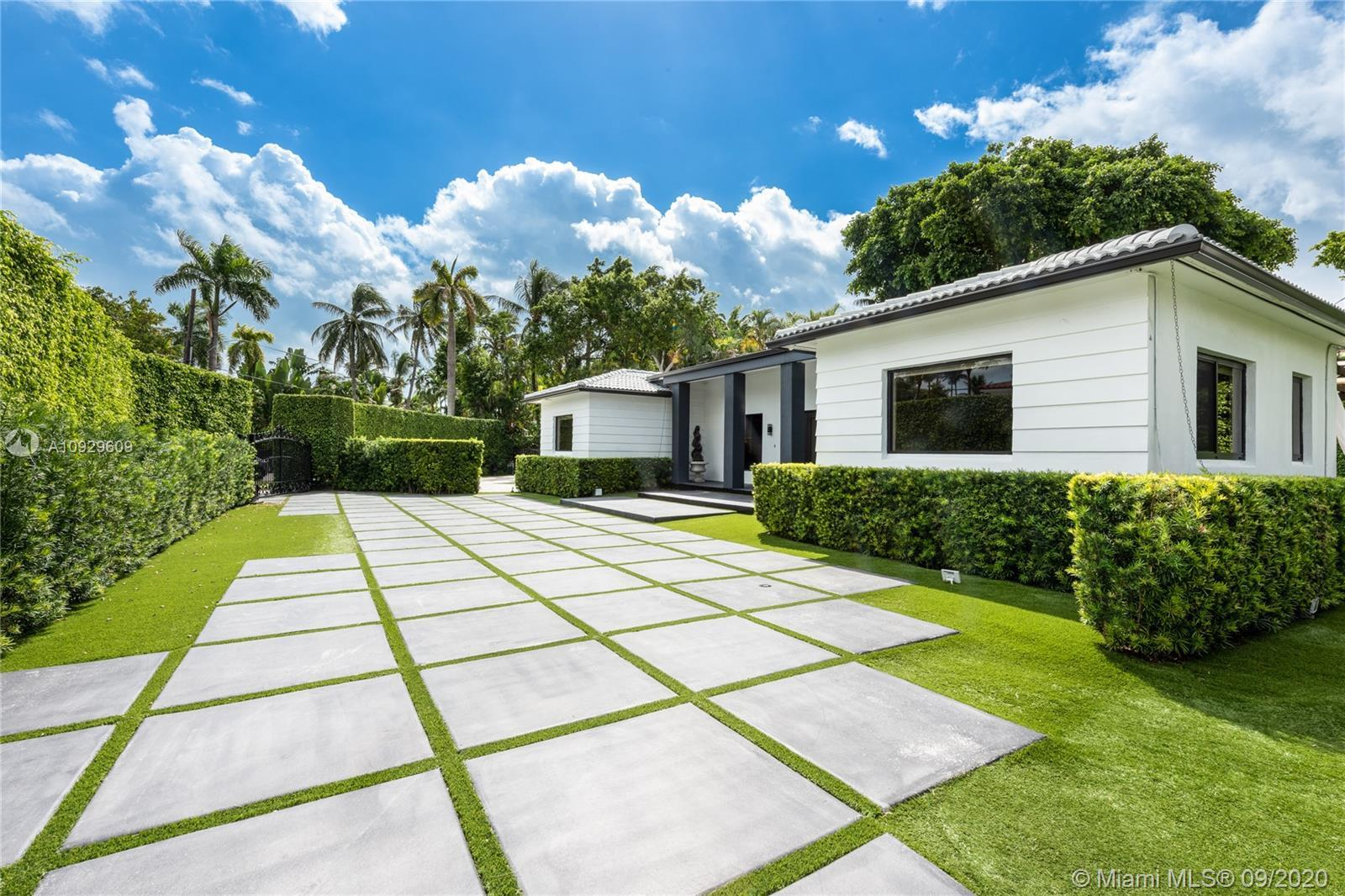 Fully renovated 4 bed/3.5 bath contemporary home located on gated Hibiscus island. This home embodie